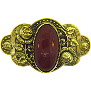 Early 1900's thin metal Brooch with oval carnelian colored glass stone