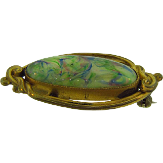 Art Nouveau scatter pin with oval swirled glass stone