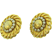 Signed Trifari gold tone circular clip on earrings with imitation pearls