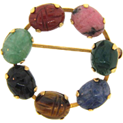Marked 1/20 14kt gold filled small circular Brooch with semi precious carved stone scarabs