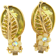 Vintage clip on Earrings in a floral design with a yellow Lucite stone