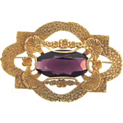 Large Victorian gold tone Sash Pin with deep purple center glass stone