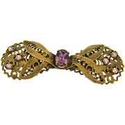 Early open filigree bow shaped Brooch with purple glass stones
