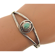 Marked sterling Cuff Bracelet with small turquoise stones