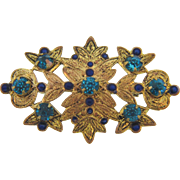 Small early Brooch of bright gold tone leaves with blue enamel and rhinestones