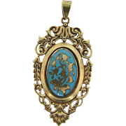 Gorgeous early Pendant with an ornate frame and center enamel with floral design