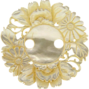 Beautiful vintage mother of pearl floral carved Button