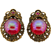Marked made in W Germany clip on Earrings with iridescent red cabochon