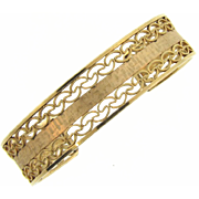 Vintage gold tone cuff Bracelet in a open filigree design