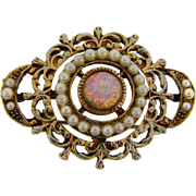 Delicate ornately designed gold tone Brooch with imitation pearls and opalescent glass cabochon