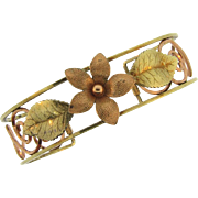 Signed Krementz two tone open cuff Bracelet with a floral design