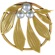 Signed Joseff large circular floral Brooch with a trio of imitation pearls