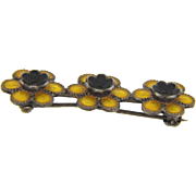 Marked sterling vintage Bar Pin with three flowers in black and yellow enamel