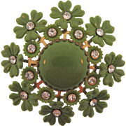 Early plastic floral Brooch in olive green with crystal rhinestones