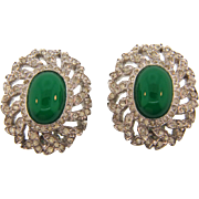 Signed Jomaz classic rhinestone clip on Earrings with a center green cabochon