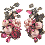 Signed Eugene large clip on earrings in shades of pink rhinestones and imitation pearls