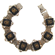 Book chain link Bracelet with raised black glass tiles featuring tiny Comedy masks