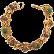 Signed Florenza renaissance look link Bracelet with shield, maltese cross and fleur de lis charms