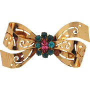 Signed Coro 1940's pierced bow Brooch with center turquoise and pink rhinestones