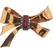 Signed Coro 1940's bow Brooch with center crystal and red rhinestones