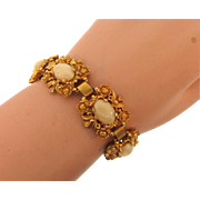Signed Judy Lee gold tone floral link Bracelet with opaque cream colored glass stones