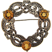Signed Miracle Scottish Celtic design Brooch with light topaz colored rhinestones