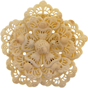 Large celluloid lacy floral brooch