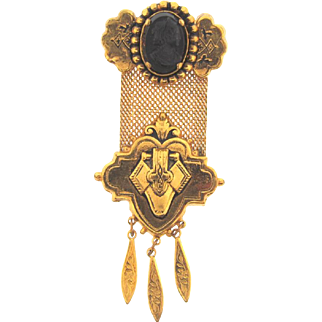 Vintage Victorian revival style Brooch in a medal design with black celluloid cameo and dangles