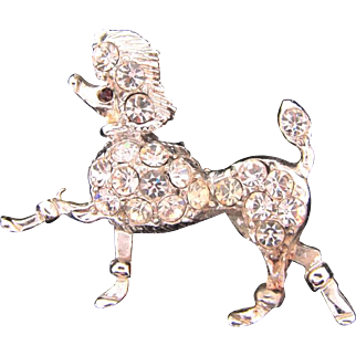 Vintage 1950's figural Brooch of a prancing poodle dog with crystal rhinestones and red stone eye