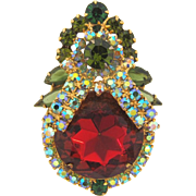D&E Juliana Brooch with shades of green rhinestones and a large dark topaz glass stone