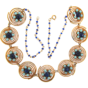 Unusual vintage coil link Necklace with center floral designs with shades of blue beads