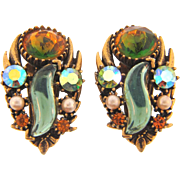 Signed Florenza large clipback Earrings with unusual rhinestones in an antiqued feather setting