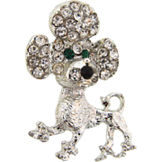 Vintage 1950's figural Brooch of a poodle dog with crystal and green rhinestones