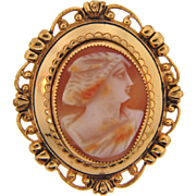Vintage gold tone brooch with center carved shell cameo
