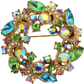 Gorgeous 1960's rhinestone circular Brooch in pastel shades with crescent moon and small imitation pearls