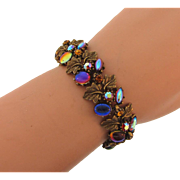 Signed ART vintage leaf link Bracelet with unusual jelly bean cabochons, iridescent navettes, AB and topaz colored rhinestones