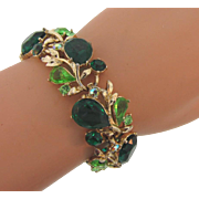 Signed ART link Bracelet in a vine design with shades of green rhinestones