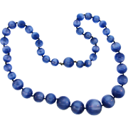 Vintage moonglow lucite bead necklace with graduating sized bead in a deep blue color