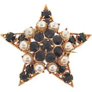 Small star shaped Scatter Pin with a raised center with imitation pearls and deep red rhinestones