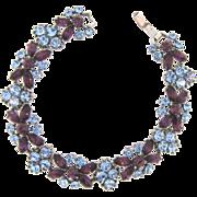 Signed Trifari rhinestone link Bracelet in purple and blue tones