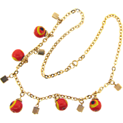 Vintage 1970's gold tone necklace with art glass beads and gold tone cubes