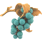 Signed Boucher 8853P gold tone Brooch with grape cluster turquoise composition beads