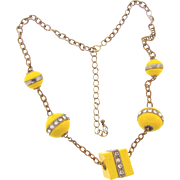 Unusual Art Deco Necklace with yellow composition spheres and cube and ringed in crystal rhinestones - Red Tag Sale Item