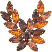 Classic 1960's rhinestone Brooch in a floral design in fall shades of topaz