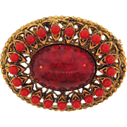 Marked made in Germany West small oval Brooch with center mottled glass cabochon and composition beads-