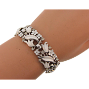 Signed Crown Trifari silver tone Bracelet with white enamel flowers and crystal rhinestones