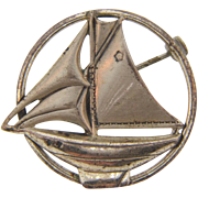 Marked sterling small round sail boat Brooch