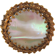 Early gold tone Brooch in an Etruscan design with large Mother of Pearl disk