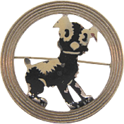Vintage Brooch featuring a black and white cartoon character dog