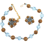 Signed Lisner choker Necklace and clip back Earrings in blue crystal beads and gold tone filigree balls